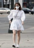 Kate Mara looks cute in a white mini dress with matching converse as she steps out in Beverly Hills, California