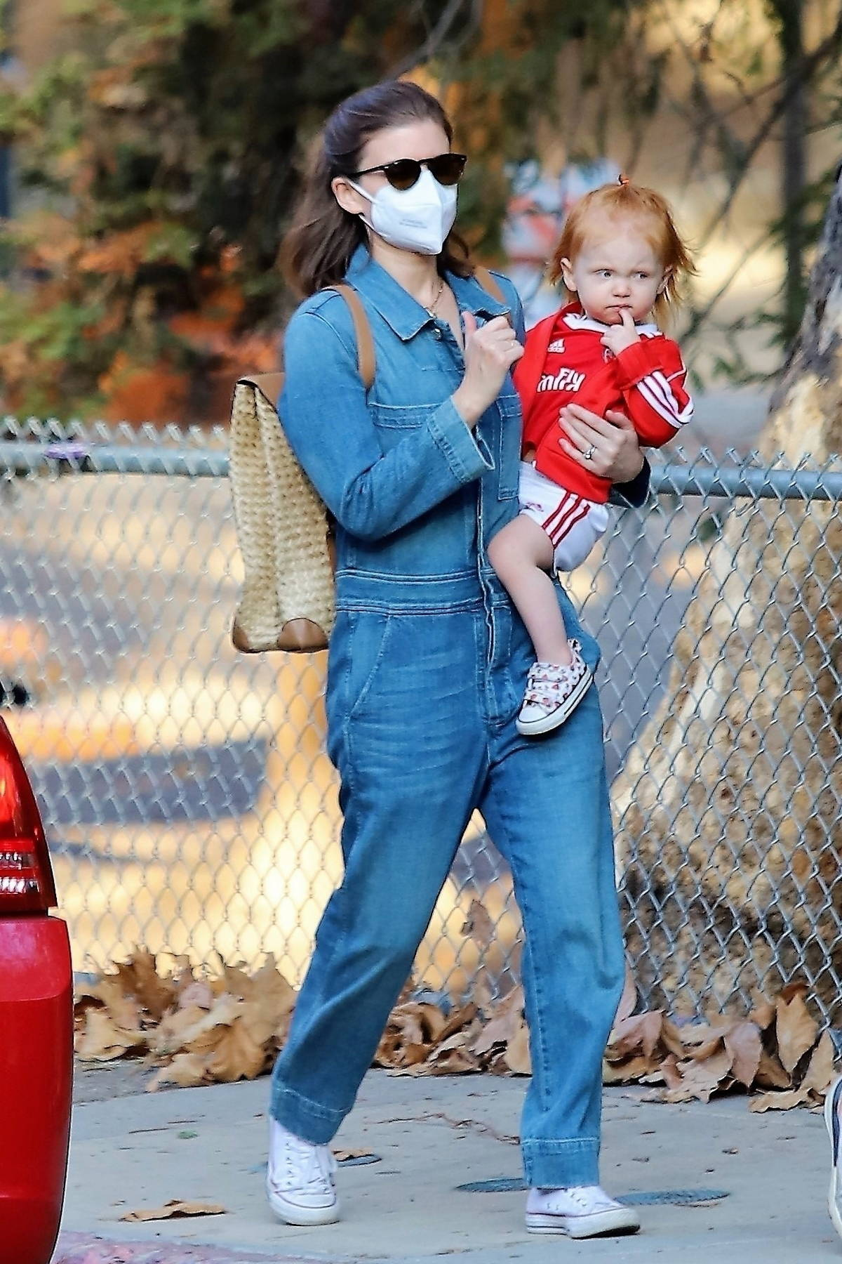 Kate Mara wears a denim jumpsuit while out for a hike with Jamie Bell and their daughter at Griffith Park in Los Feliz, California