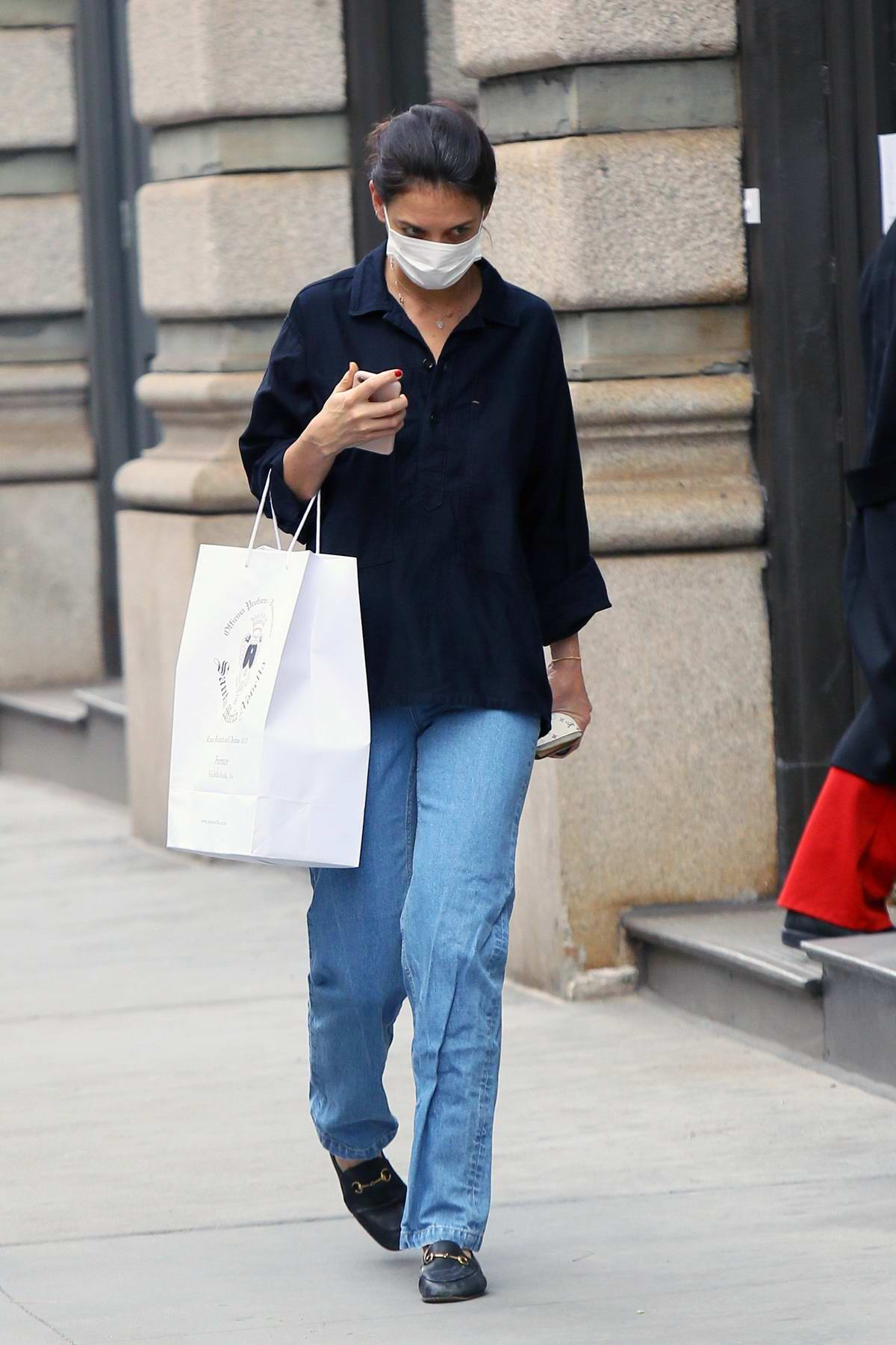Katie Holmes keeps it casual in jeans and a black shirt as she goes shopping for some perfume in New York City