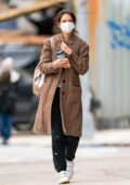 Katie Holmes seen wearing a brown long coat and paint-splattered sweatpants as she heads to a studio in New York City