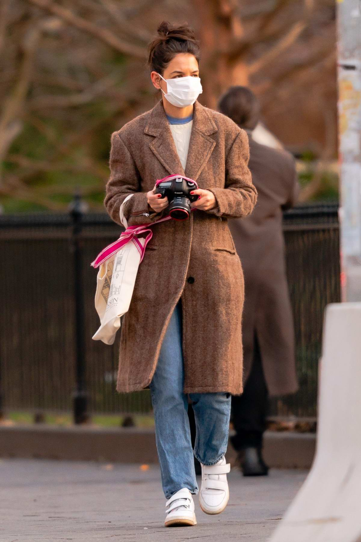 Katie Holmes takes some photographs while visiting the Washington Square Park in New York City