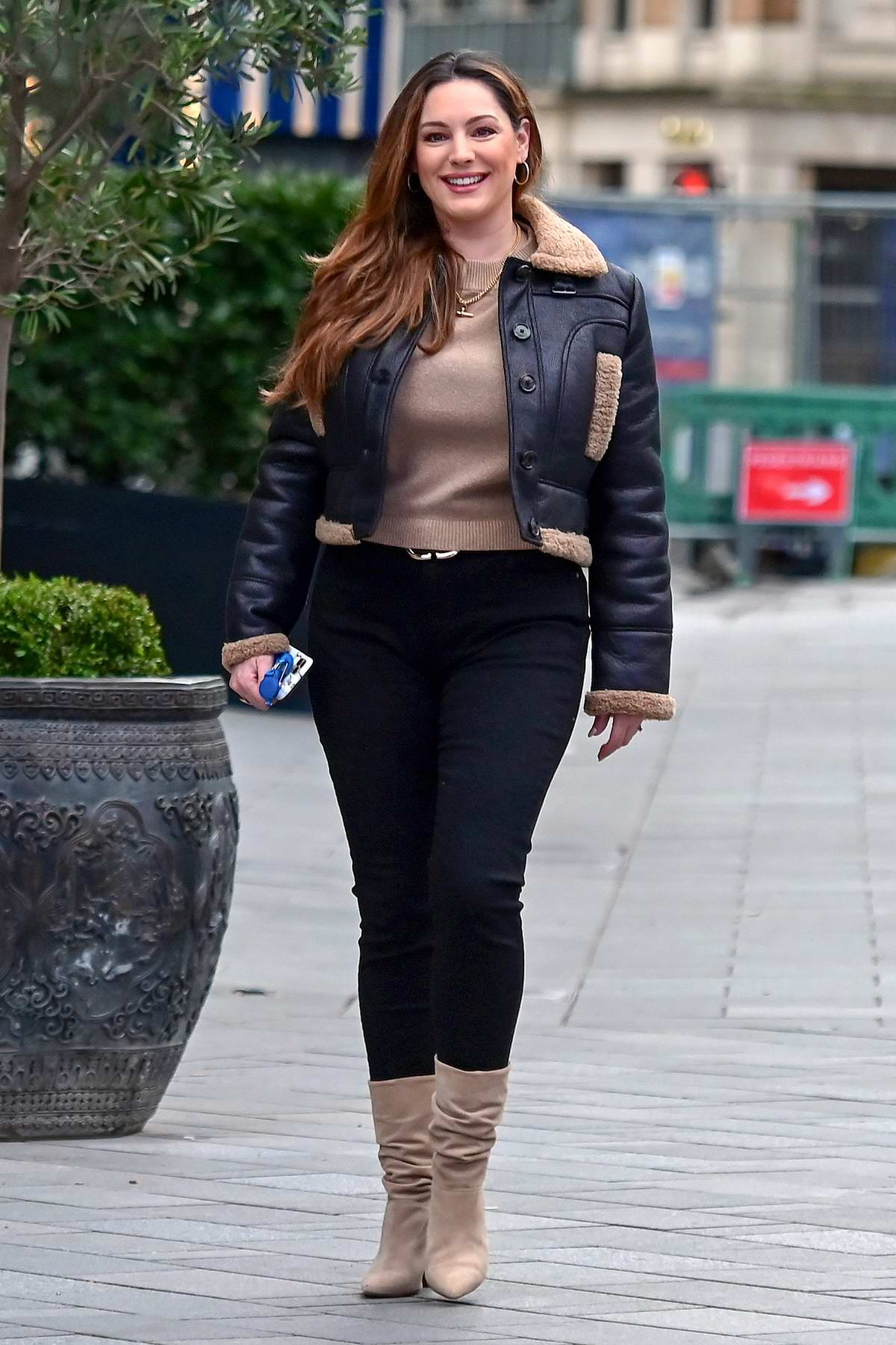 Kelly Brook flashes her lovely smile for the camera while arriving at the Global Radio Studios in London, UK