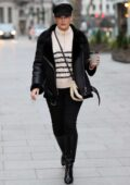 Kelly Brook looks chic in a cap and a striped sweater as she arrives at Heart radio in London, UK
