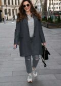 Kelly Brook looks cozy in a grey overcoat with matching denim as she arrives at Heart radio in London, UK