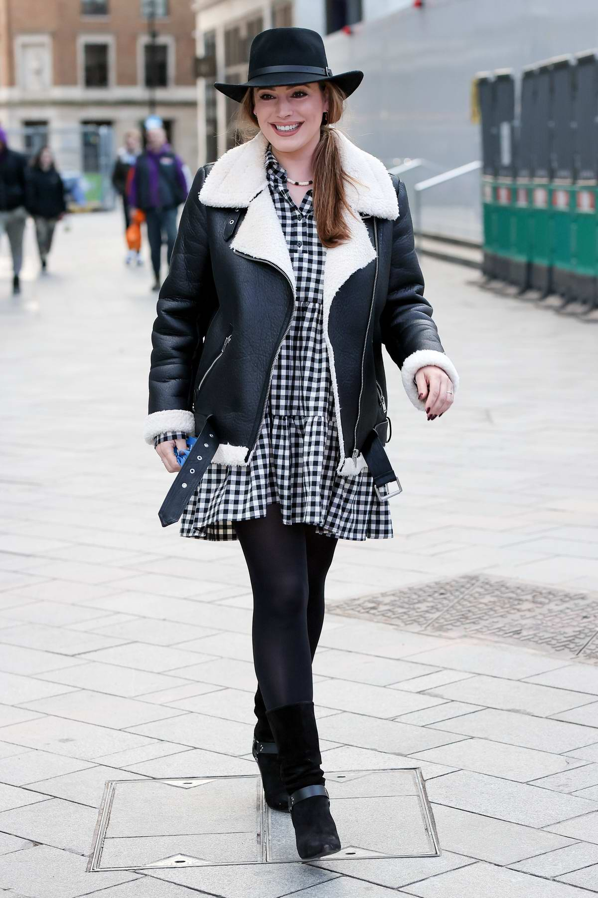 Kelly Brook looks cute in gingham mini dress and hat at Heart Radio in London, UK