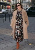 Kelly Brook looks lovely in a tan coat over a floral print dress as she arrives at Heart radio in London, UK