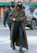Kendall Jenner looks chic in a trench coat with a sweater and leggings while shopping at Ralph Lauren in Aspen, Colorado
