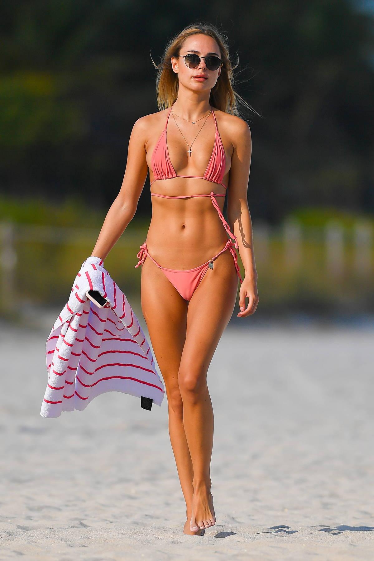 Kimberley Garner looks flawless in a pink bikini as she enjoys the beach in Miami, Florida