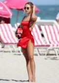 Kimberley Garner stuns in a bikini before changing into a red silk dress as she hits the beach in Miami, Florida