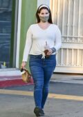 Lana Del Rey wears a white top and jeans as she picks up some food to go while out in Studio City, California