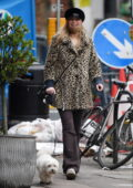 Laura Whitmore looks cozy in an animal print coat as she steps out to walk her dog in London, UK