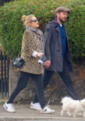 Laura Whitmore takes a romantic walk hand-in-hand with husband Iain Stirling in London, UK