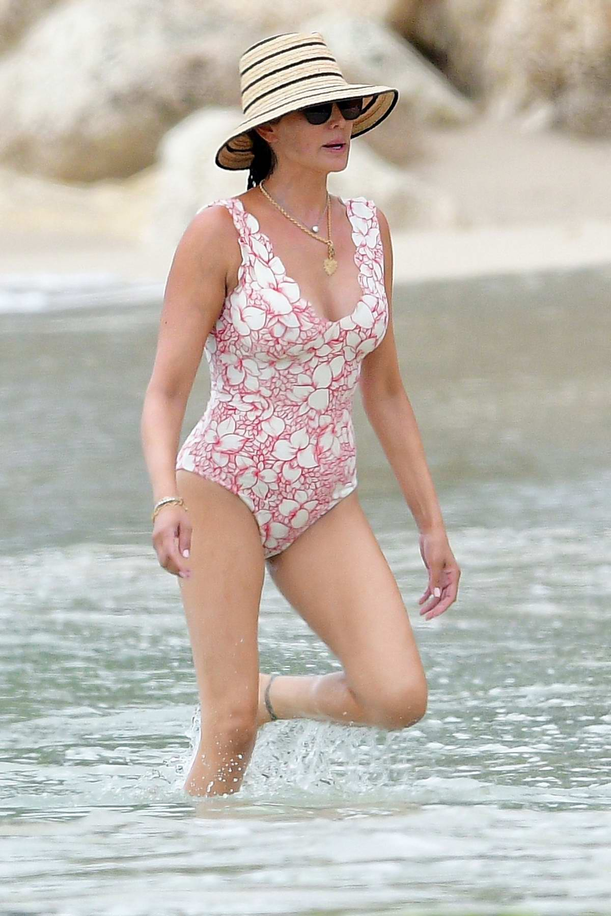 Lauren Silverman looks great in a floral print swimsuit as she hits the beach in Bridgetown, Barbados