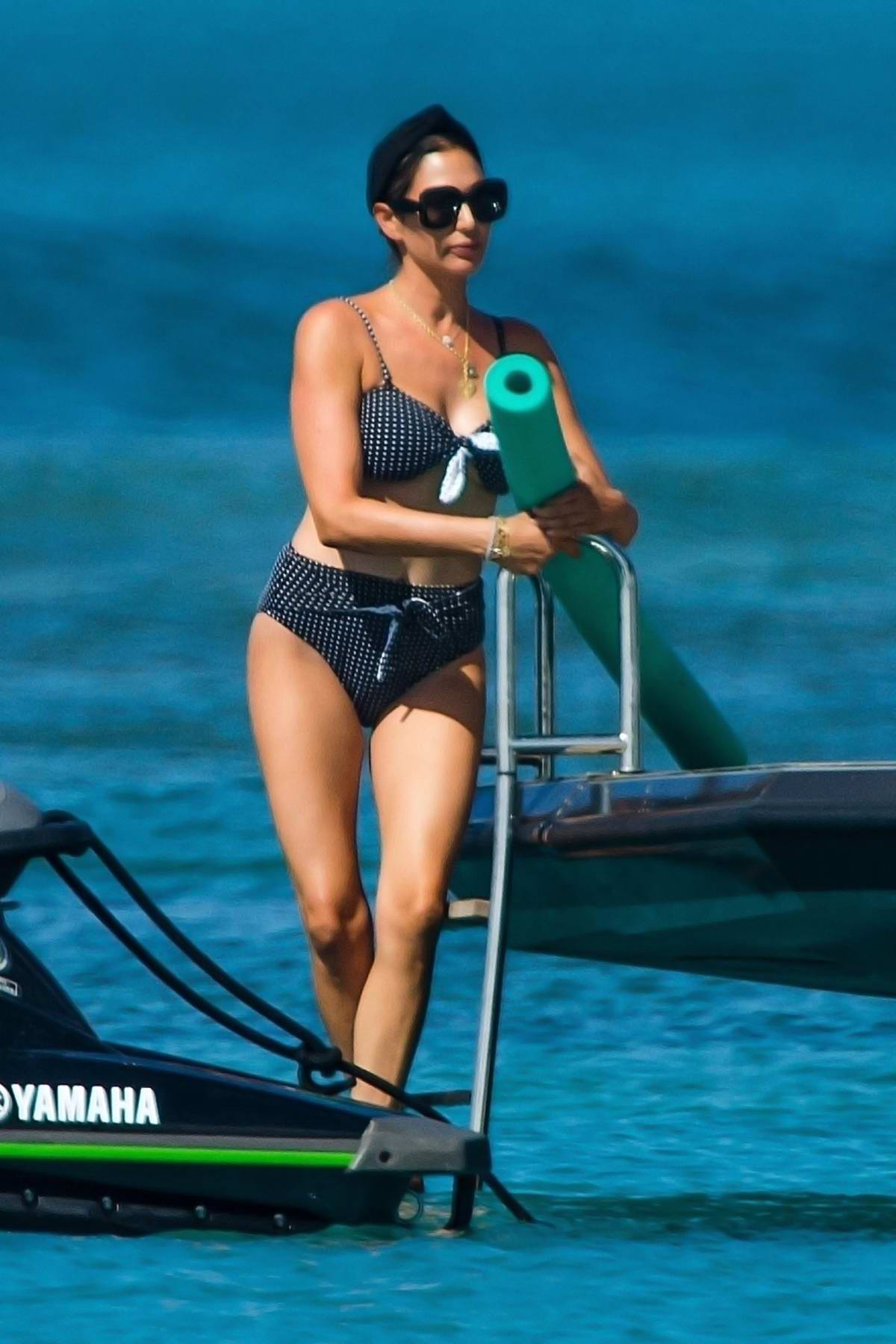 Lauren Silverman shows off her toned body in a printed bikini while relaxing on a boat in Bridgetown, Barbados