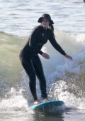 Leighton Meester hits the beach with husband Adam Brody for a morning surf session in Malibu, California