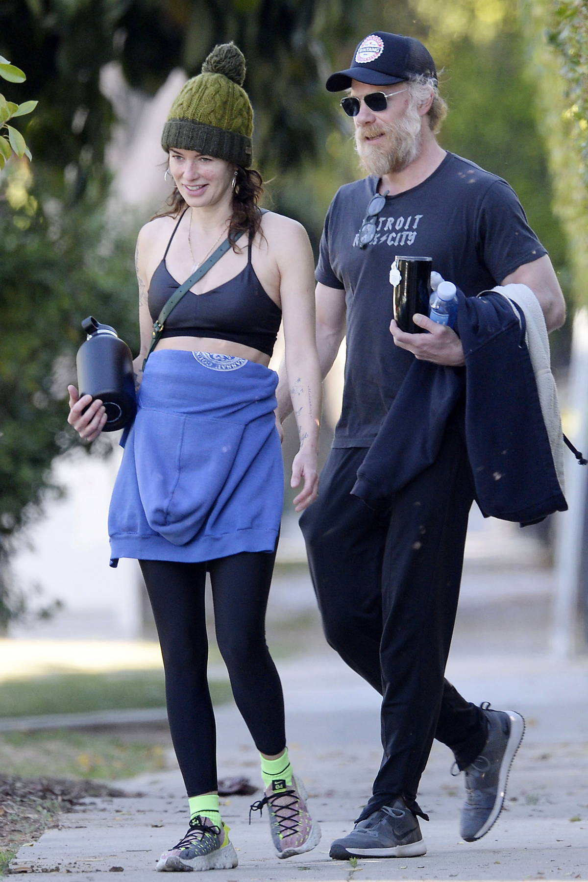 Lena Headey is all smiles after a workout at the gym with boyfriend Marc Menchaca in Hollywood, California