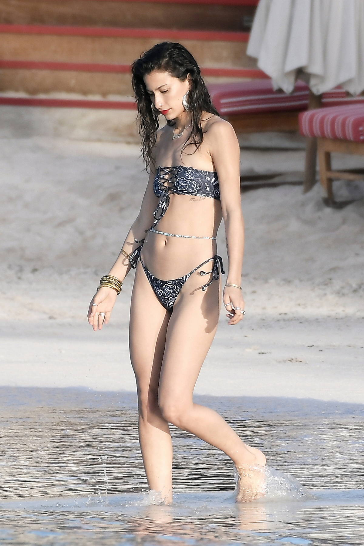 Lexy Panterra slips into a patterned bikini while enjoying the beach with friends in St Barths, France