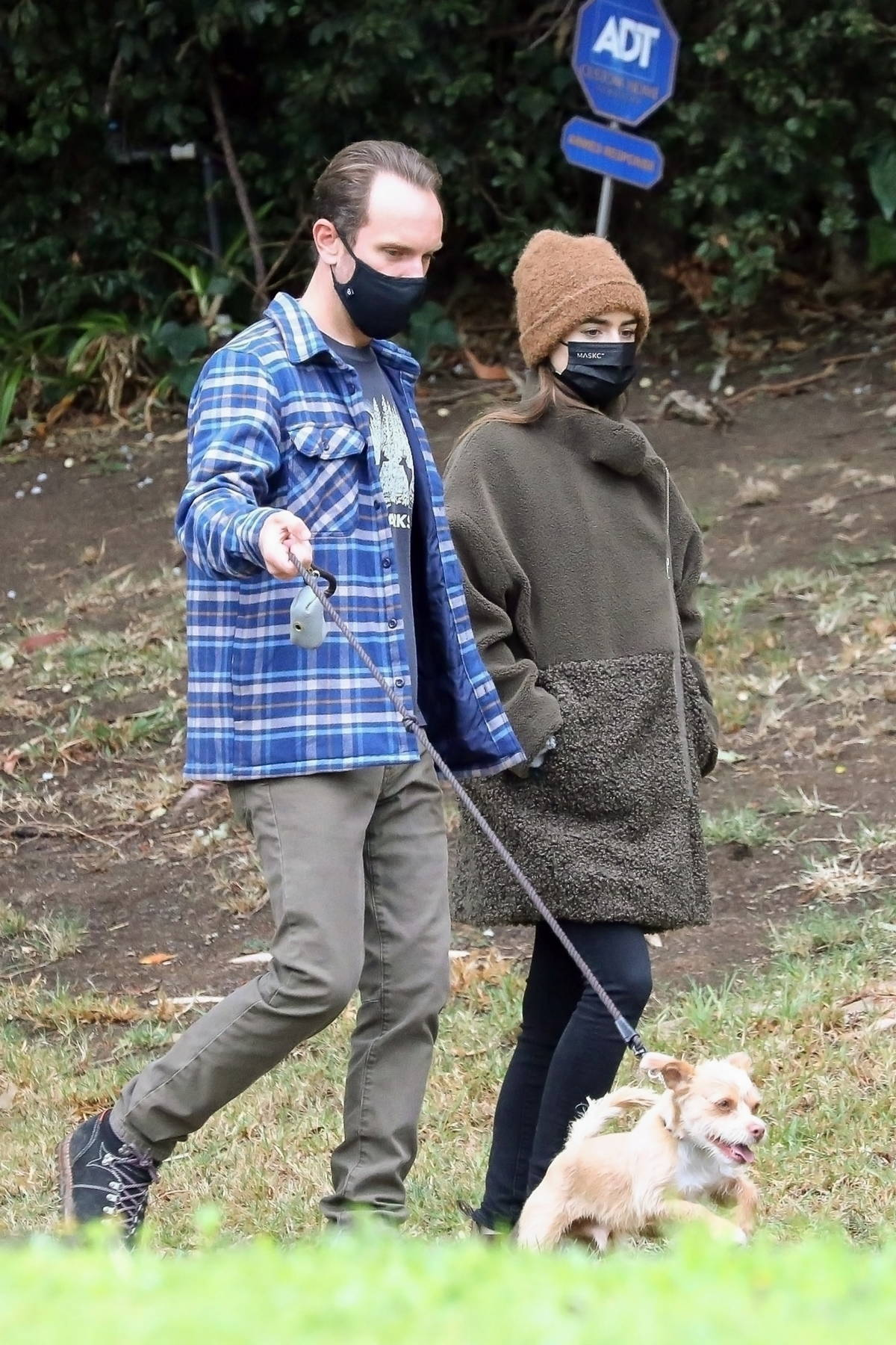 Lily Collins and Charlie McDowell step out to walk their dog in Los Angeles