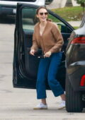 Lily Collins is all smiles as she arrives to deliver a birthday present to a friend's house in Los Angeles