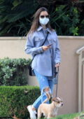 Lily Collins looks cozy in a lavender shirt jacket as she steps out to walk her dog in Los Angeles