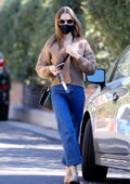 Lily Collins seen wearing a blue cardigan and jeans as she stops by a friend's place in Los Angeles