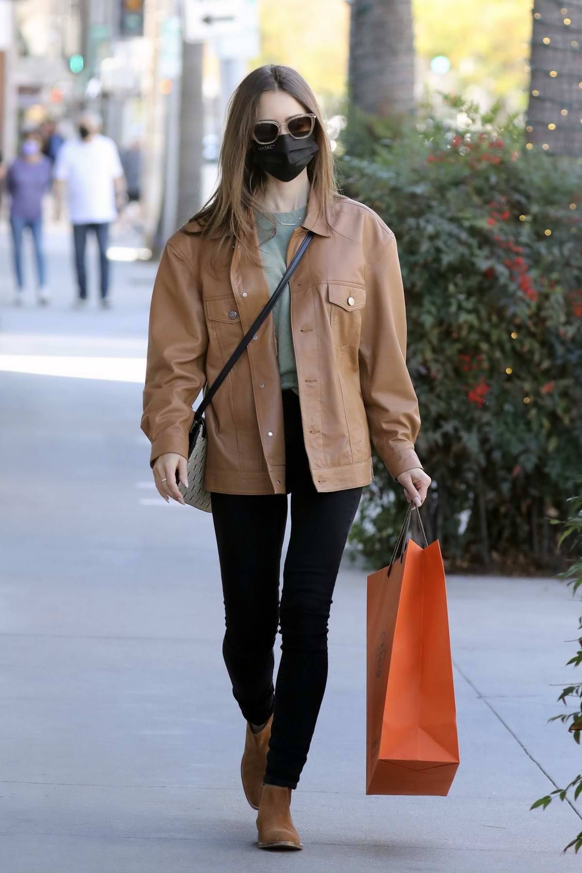 Lily Collins wears a leather jacket, denim and suede boots while out to do some shopping at Hermes in Los Angeles