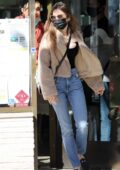 Lily Collins wears a teddy jacket and jeans for a shopping trip in Beverly Hills, California