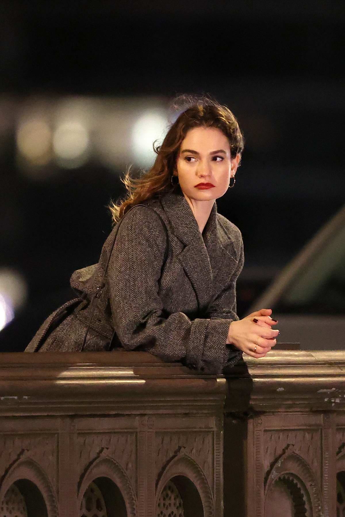 Lily James seen filming scenes for 'What's Love Got To Do With It?' on Battersea Bridge in London, UK