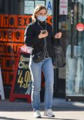 Lily-Rose Depp bundles up in a puffer jacket as she enjoys a stroll in New York City