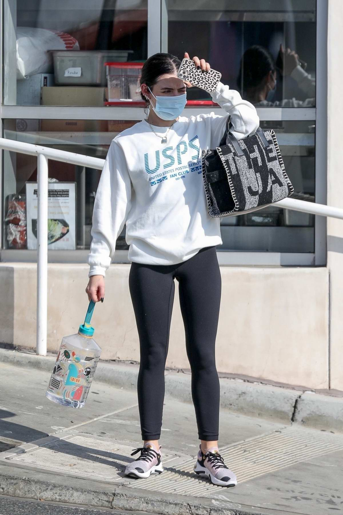 Lucy Hale dons USPS sweatshirt and leggings as she wraps up her workout and picks up some coffee to-go in Los Angeles