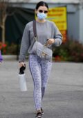 Lucy Hale sports a grey sweatshirt and animal print leggings as she heads for a workout in Los Angeles