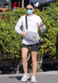 Lucy Hale sports a white sweatshirt and shorts as she heads for a workout session in Los Angeles