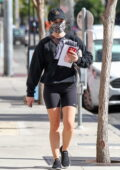 Lucy Hale sports all-black sweatshirt with bike shorts and sneakers while running a few errands in Los Angeles
