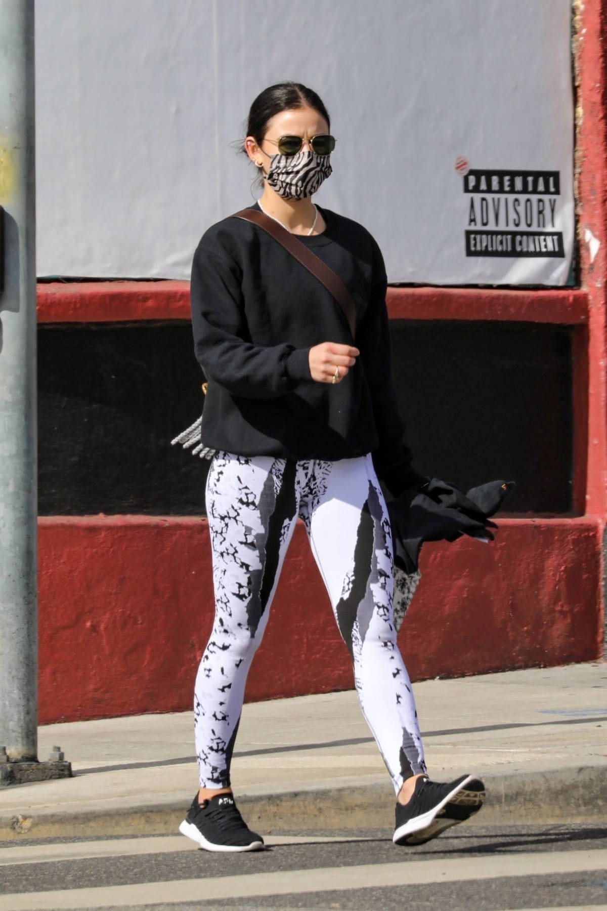 Lucy Hale sports black and white patterned leggings as hits a private gym in Los Angeles
