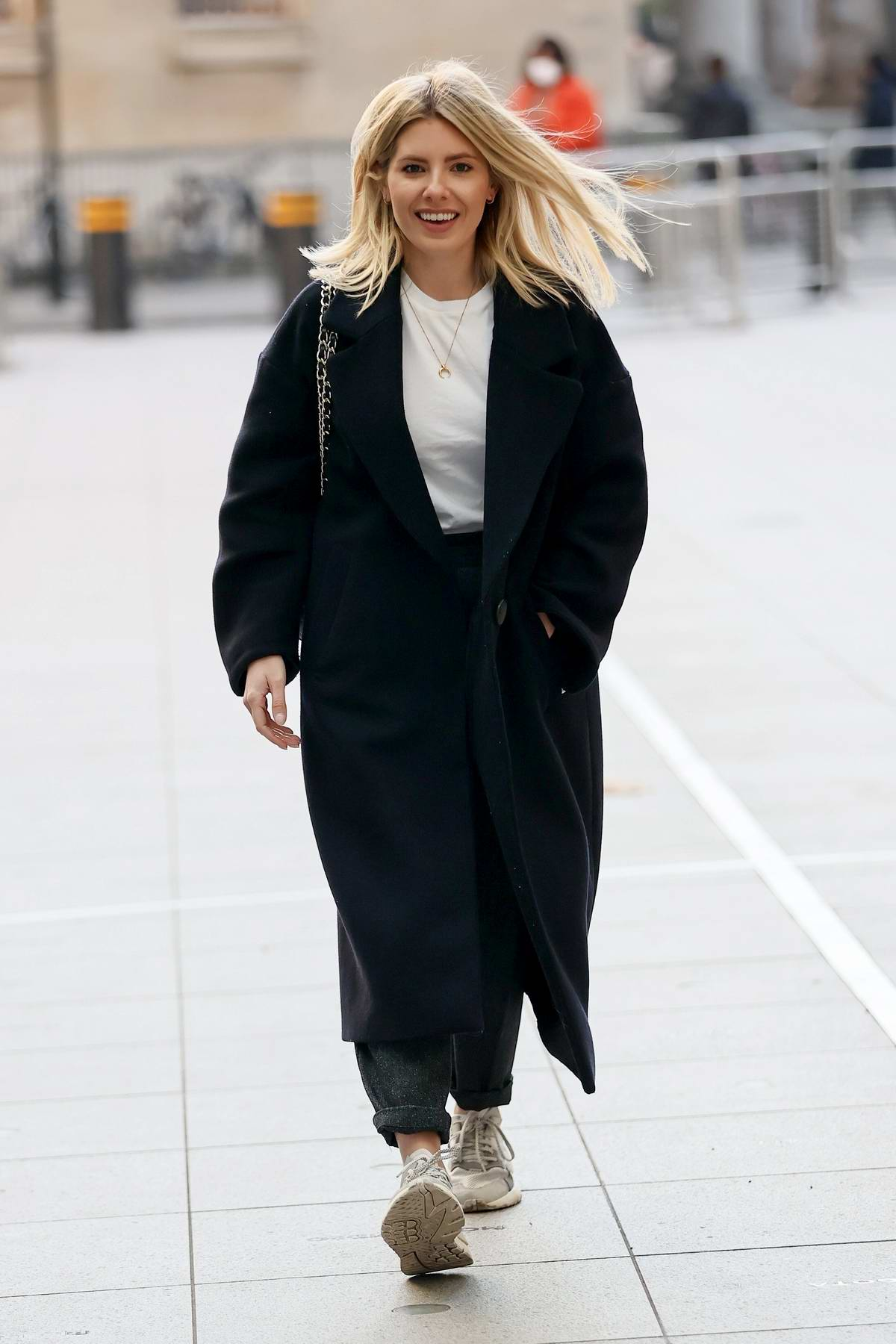 Mollie King is all smiles while flashing her engagement ring as she arrives at BBC Radio One Studios in London, UK