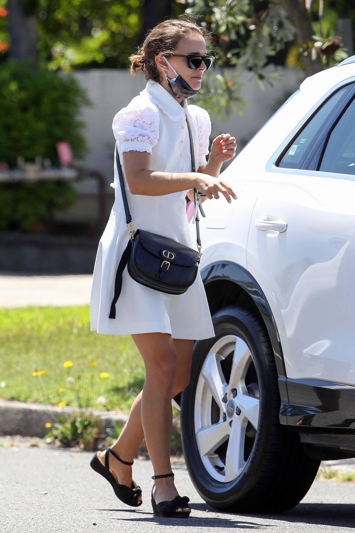 Natalie Portman seen wearing a lovely white dress while visitinga nail salon in Sydney, Australia