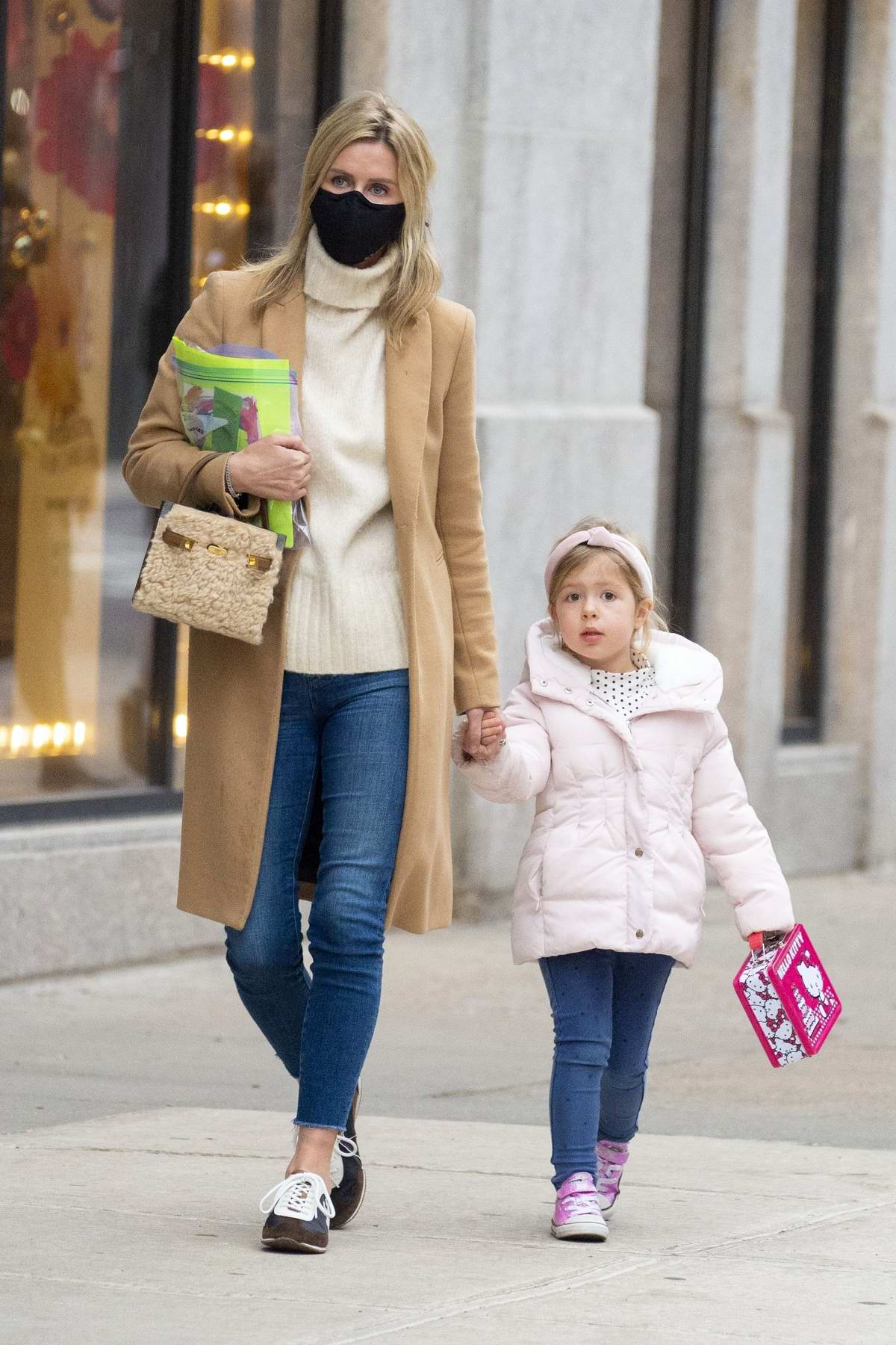 Nicky Hilton keeps it stylish as she steps out for a walk with her daughter in New York City