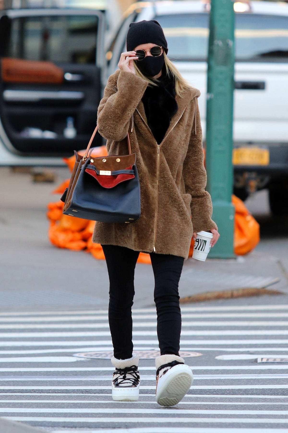 Nicky Hilton sports fashionable shoes while on a coffee run in Manhattan's Soho area, New York City