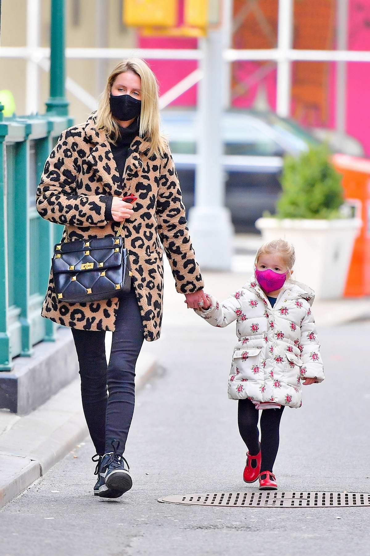 Nicky Hilton wears an animal print coat as she steps out with her daughter for a walk in New York City