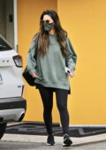 Olivia Munn wears an oversized sweatshirt with leggings as she leaves a gym in West Hollywood, California