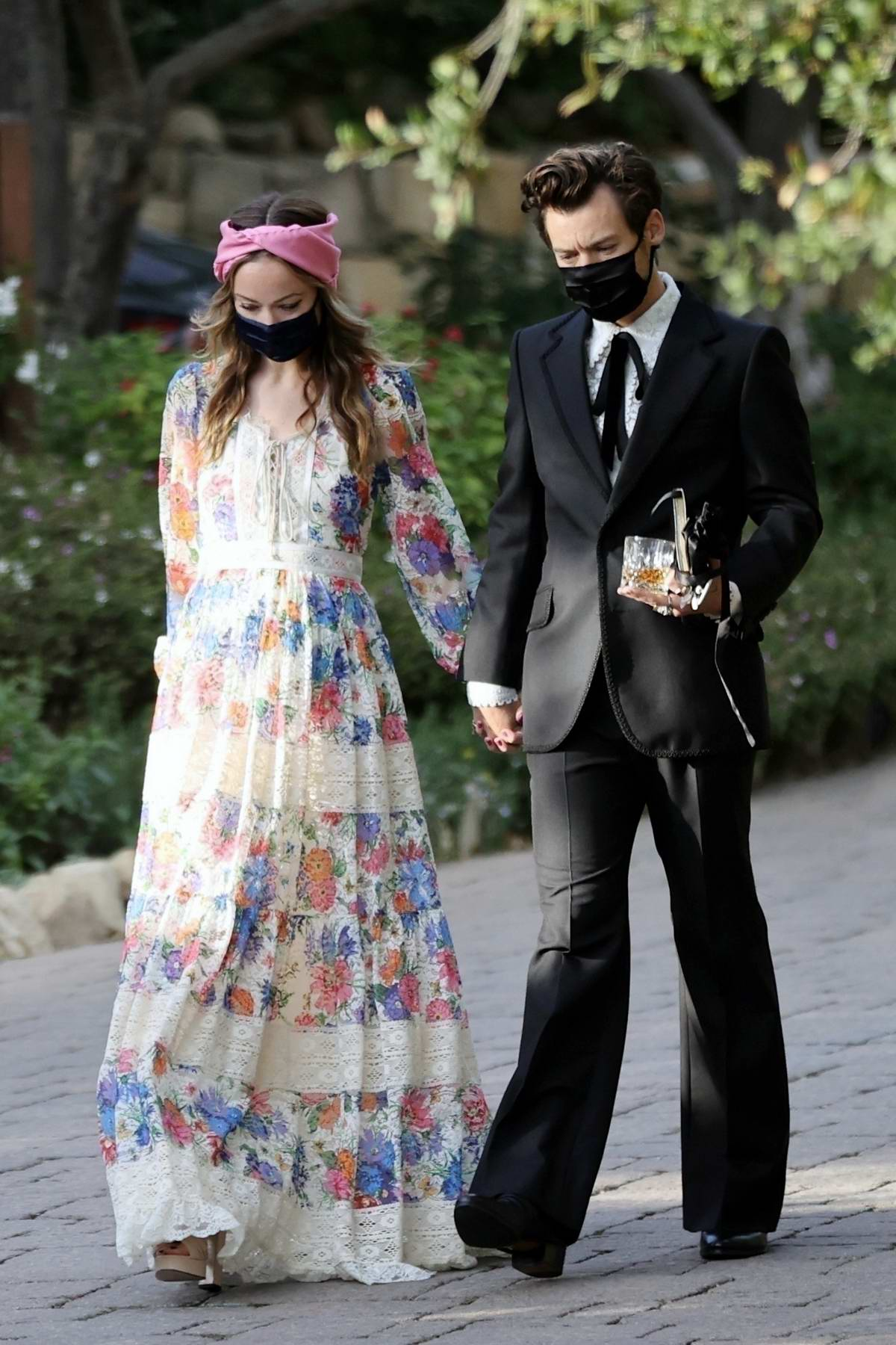 Olivia Wilde and Harry Styles hold hands while attending Harry's agent's wedding in Montecito, California