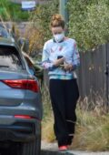 Olivia Wilde has her hands full as she arrives at her ex Jason Sudeikis' house in Los Feliz, California