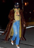 Rihanna rocks an unbuttoned shirt with a fur coat as she steps out for a dinner date with A$AP Rocky in New York City