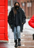 Rosalía keeps it casual in a long jacket and rolled up jeans as she steps out in New York City