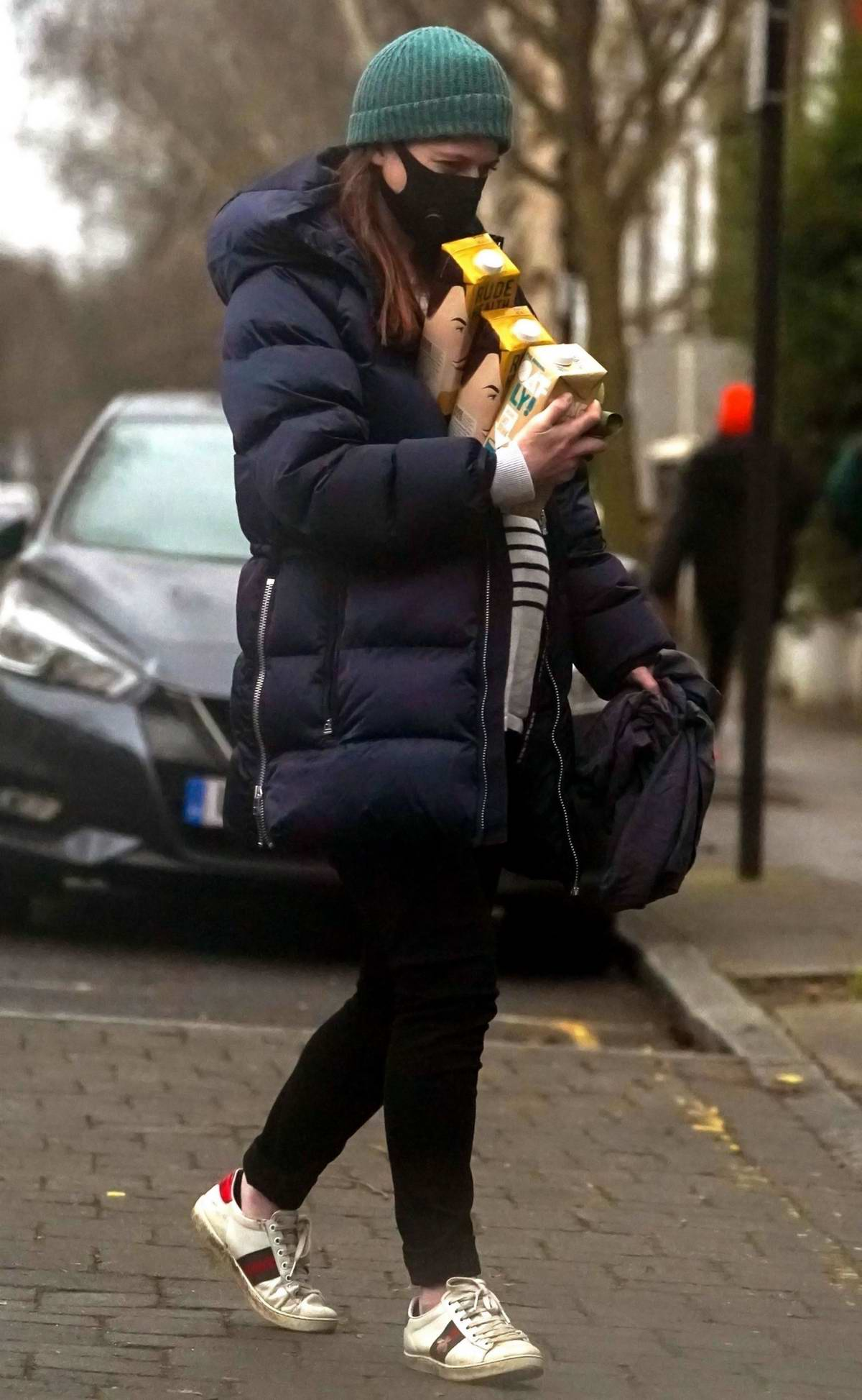 Rose Leslie shows her baby bump while out to pick up organic oat milk with Kit Harrington in London, UK