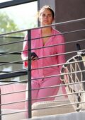 Sara Sampaio looks comfy in her pink pajamas as she relaxes on her balcony while on her phone in Los Angeles
