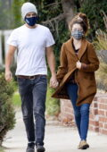 Sarah Hyland holds hands with her fiancé Wells Adams while on a morning stroll together in Hollywood, California