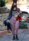 Scout Willis wears striped pants and a graphic tee while visiting a friend with her dog in Los Angeles
