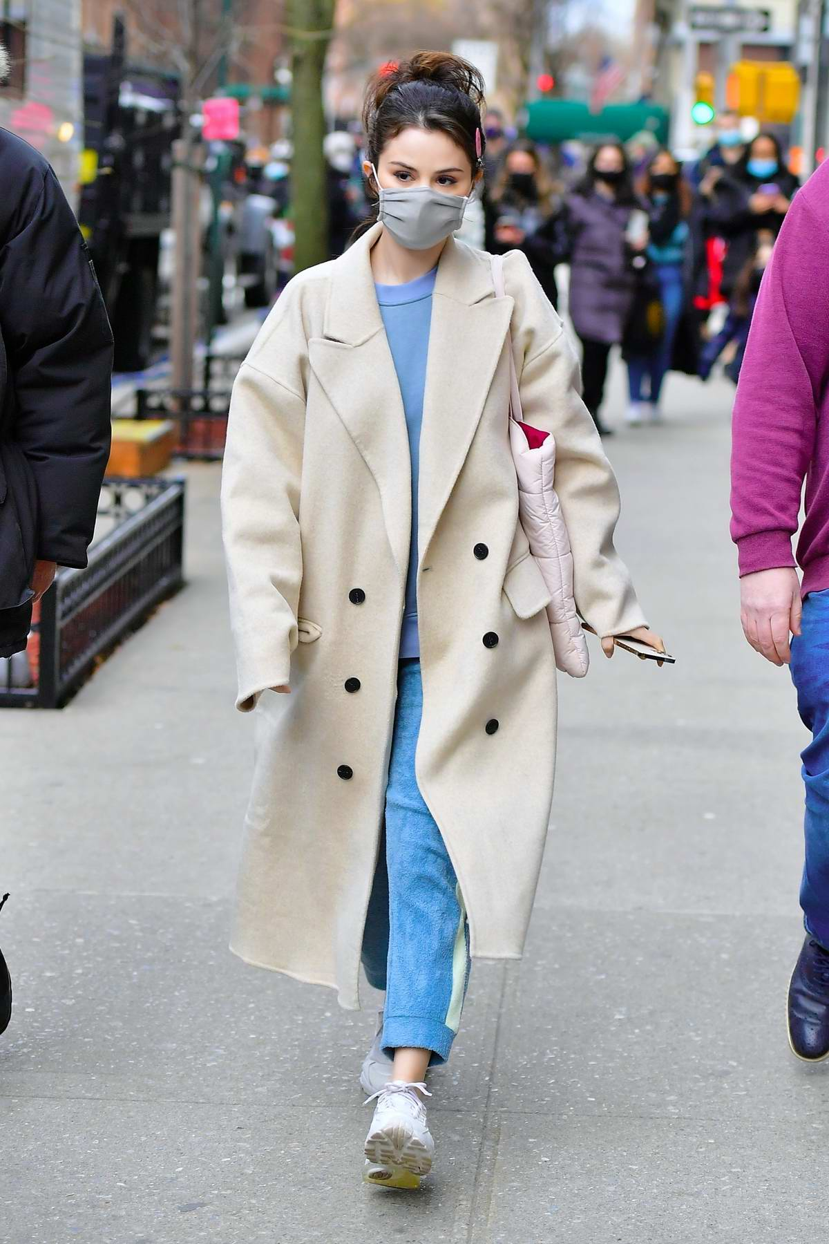 Selena Gomez looks cute in an off-white overcoat as she heads to the set of 'Only Murders in The Building' in New York City