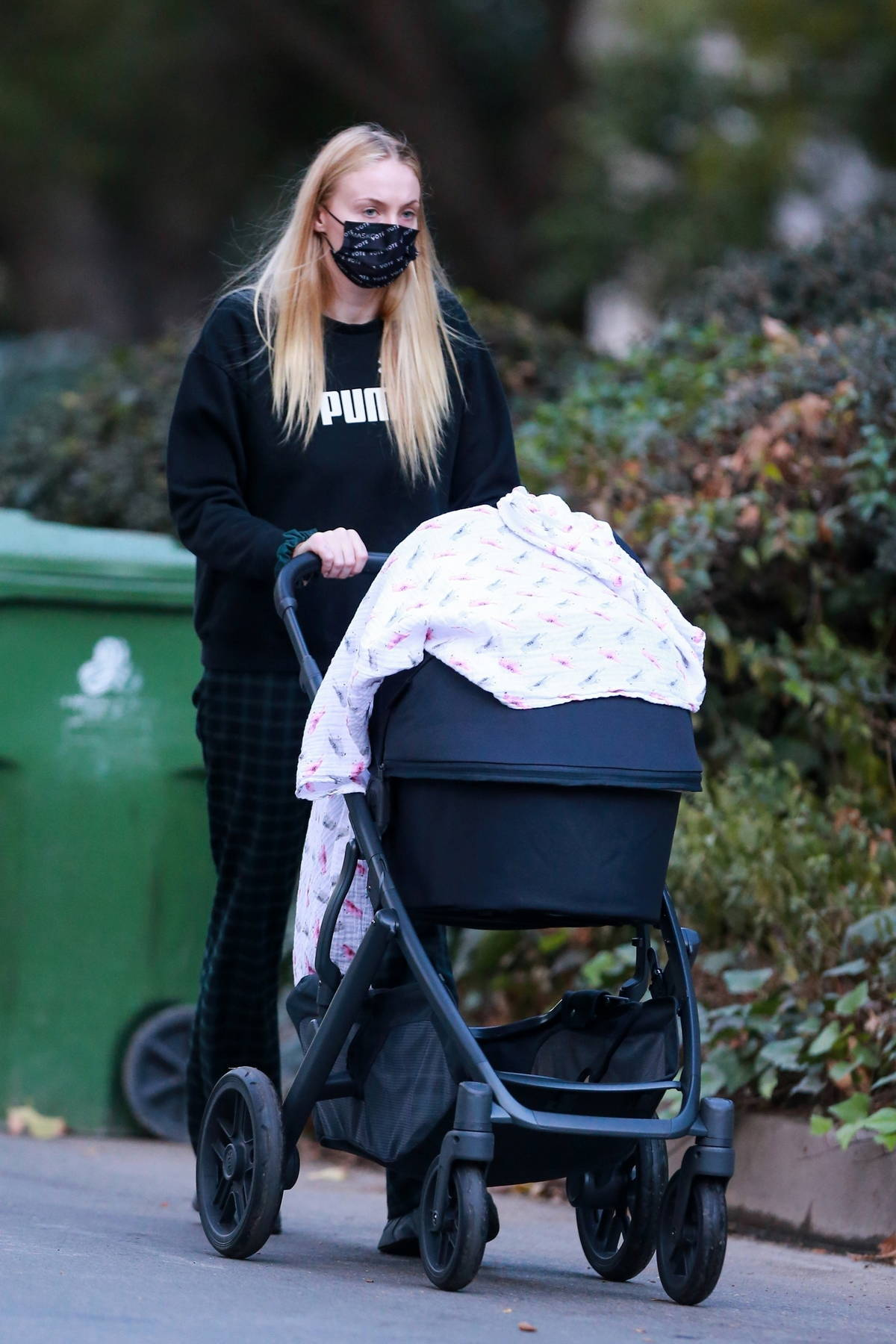 Sophie Turner takes her baby girl Willa out for an afternoon walk near her home in Los Angeles